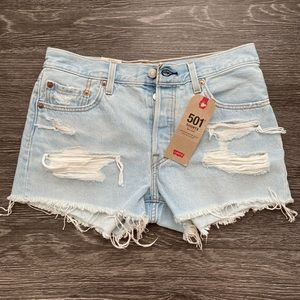 Levi mid rise distressed shorts